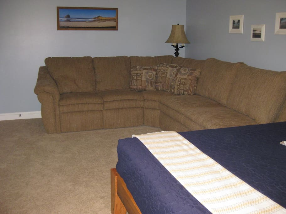 Sectional couch with full size foldout bed