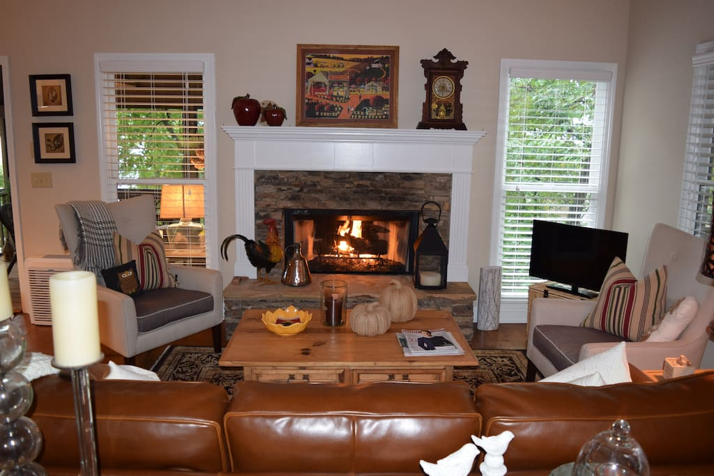 The main level living room comes complete with easy to operate  gas fireplace.
