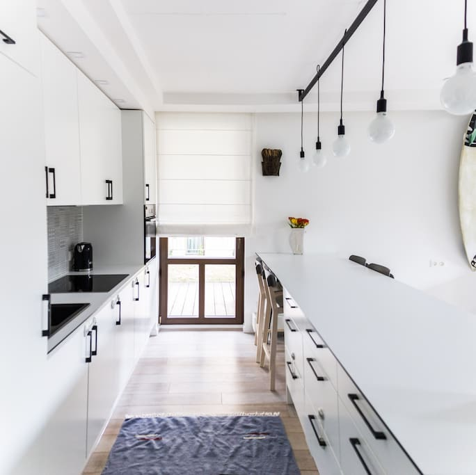 Spacious kitchen together with the door to the big private terrace.