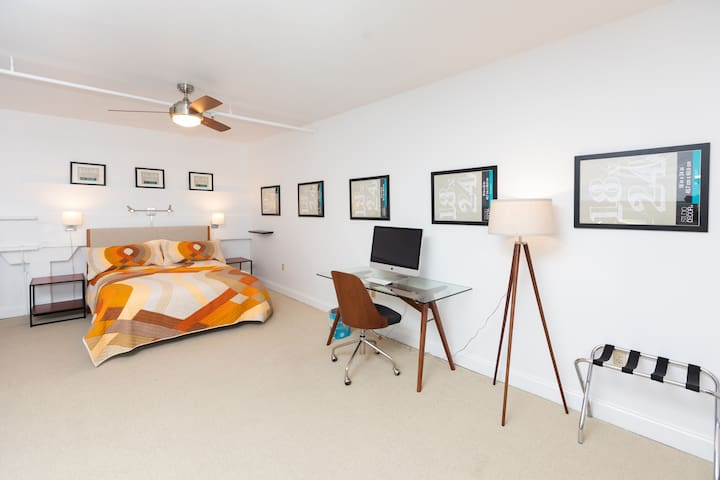 A large lofted area with a luxurious queen sized bed.