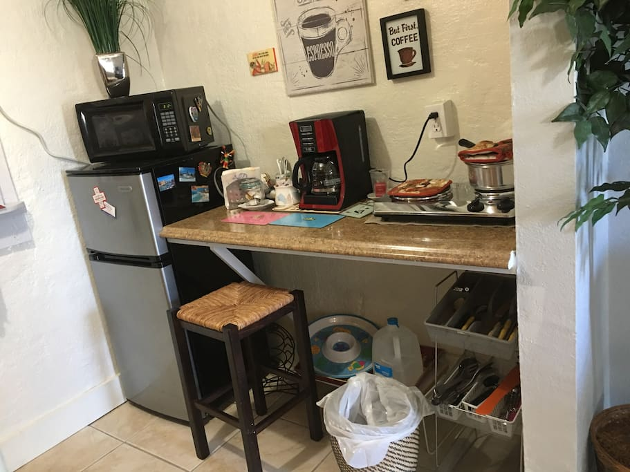 Small kitchenette with fridge, coffee maker, 2 burner stove top