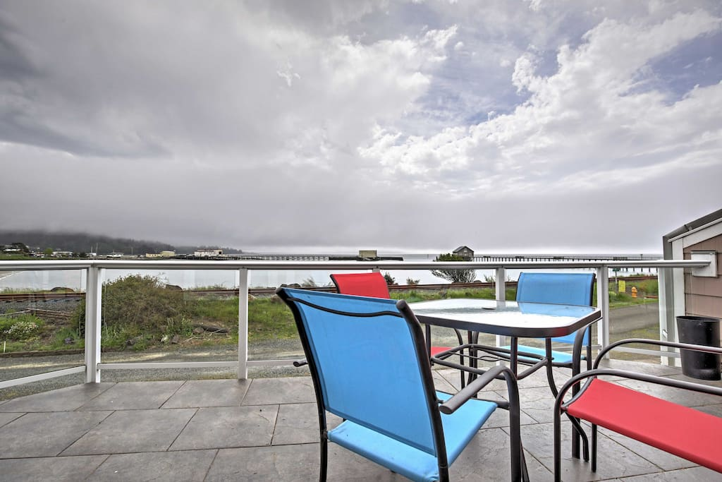 The furnished deck overlooks the serene Tillamook Bay.