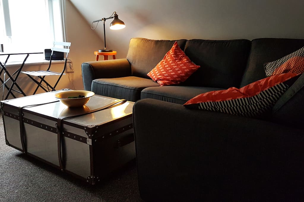 Living room: a sofa bed, dining area, TV with NowTV box and SegaMega drive for those rainy afternoons.
