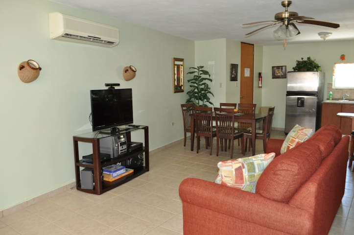 Living, entertainment center and dining areas view