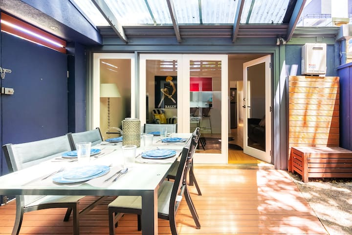 Light, bright and stylish the cottage features an outdoor entertaining area.