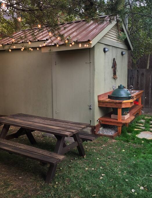 Picnic table with outdoor kitchen featuring BigGreenEgg BBQ Grill