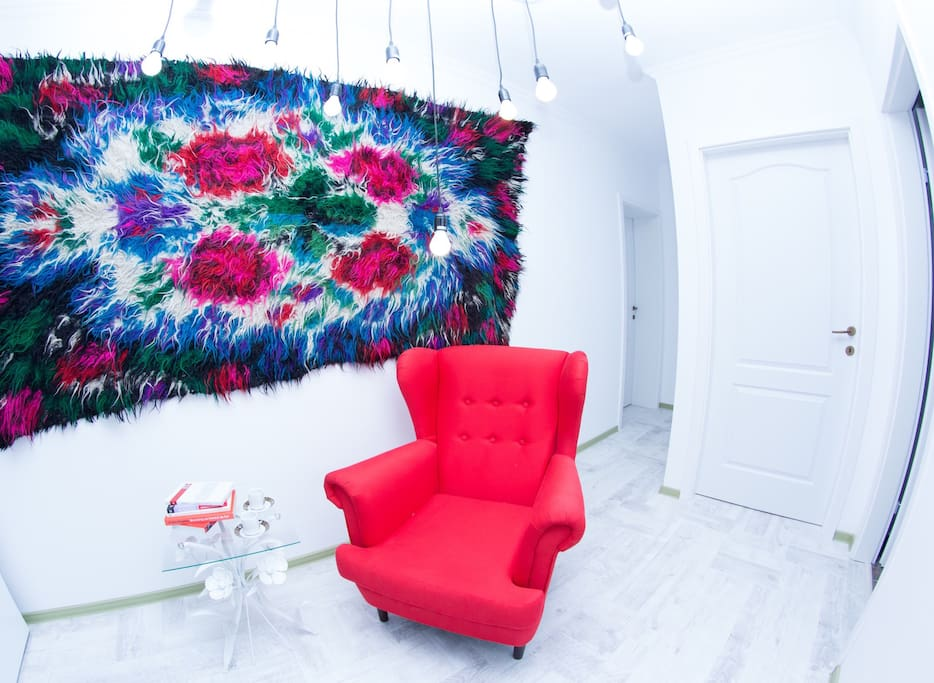 One of the most transylvanian spot of the apartament is this colorfull Cerga- a sheep blanket colored by hand. You can always see them in transylvanian houses. How about relaxing and reading a book in this awesome armchair?