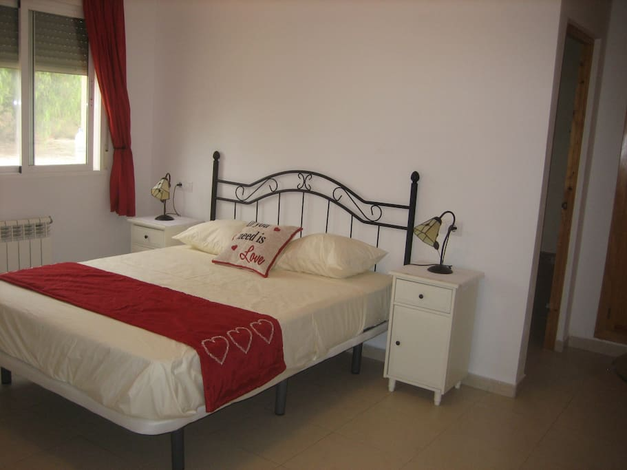 Part of the Poppy suite King sized bed.  This room has en-suite shower room & private lounge
