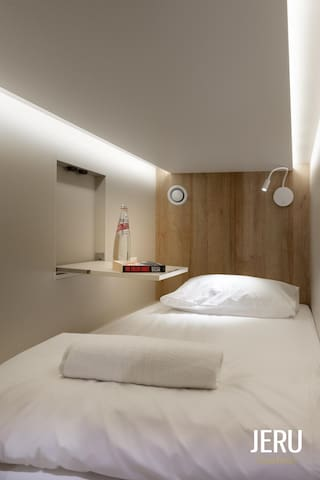 Bright and Cozy Capsule Hotel