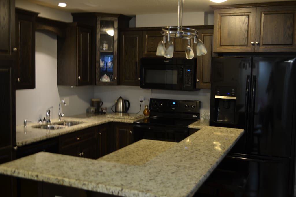 Granite counters and pot lights throughout this kitchen space.