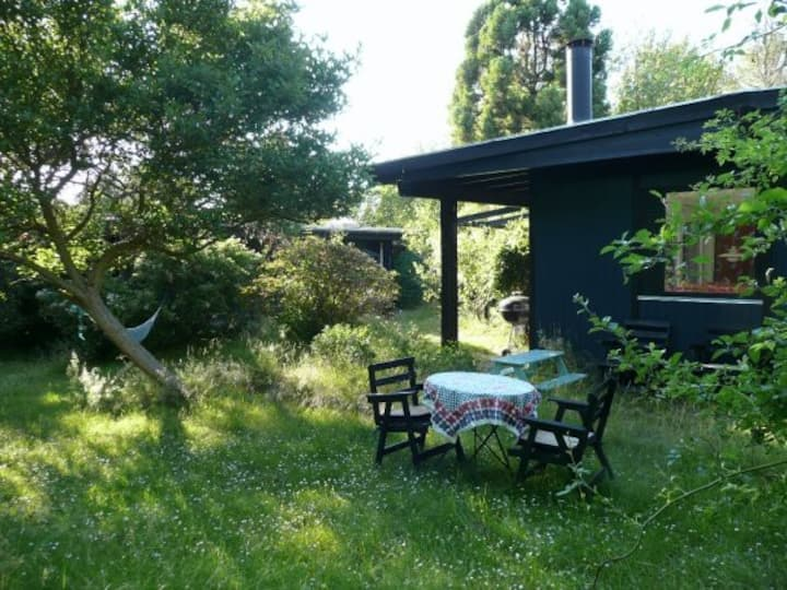 Charming house in secluded garden in Tisvilde