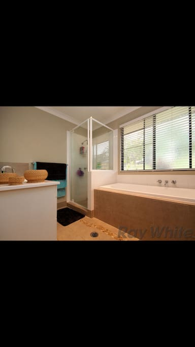 Your private bathroom with deep bath and salts provided