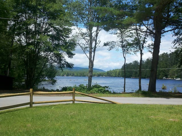 View of lake and rear yard
