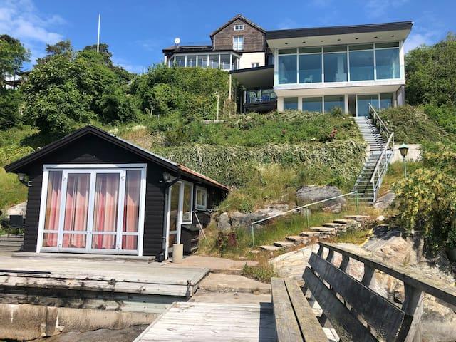 Modern seaside villa with boathouse and sauna