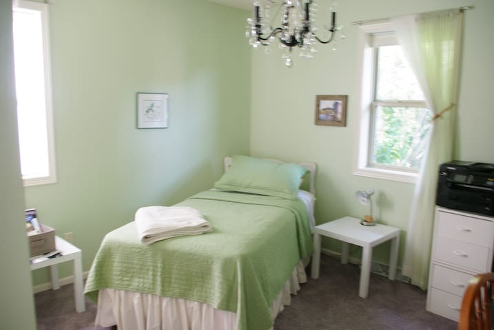 Bedroom 3 Single with closet and desk. Adjacent to Bathroom 2 which is shared with other guests. Contains office space (pictures of layout may vary).