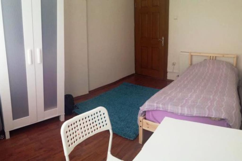ROOM 105 is a big room having 1 single bed, 1 wardrobe, 1 desk and chair.