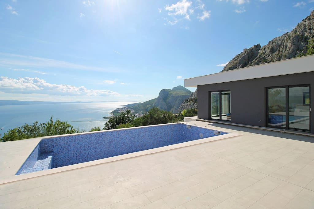 Finishing work in progress, 32 sqm pool with massage, opened sea and coast views