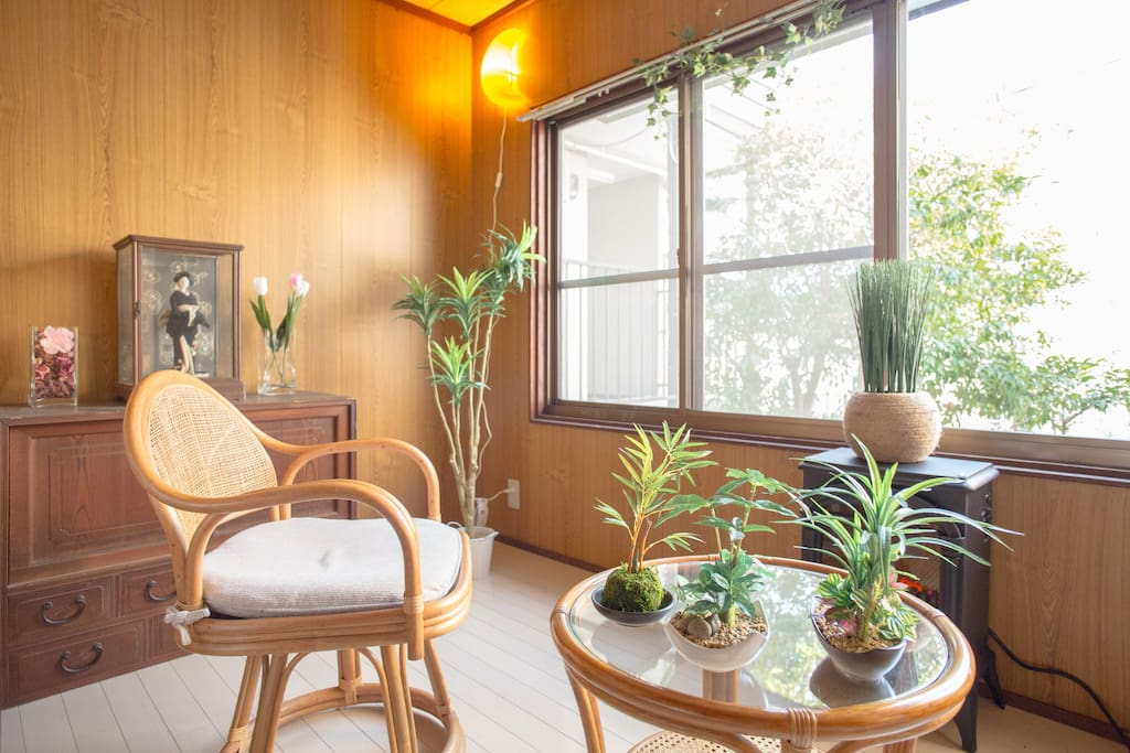 Sun room includes travel books, an electric stove-fireplace, and a great place to relax!