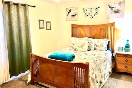 Private, spacious guest bedroom in a large house.