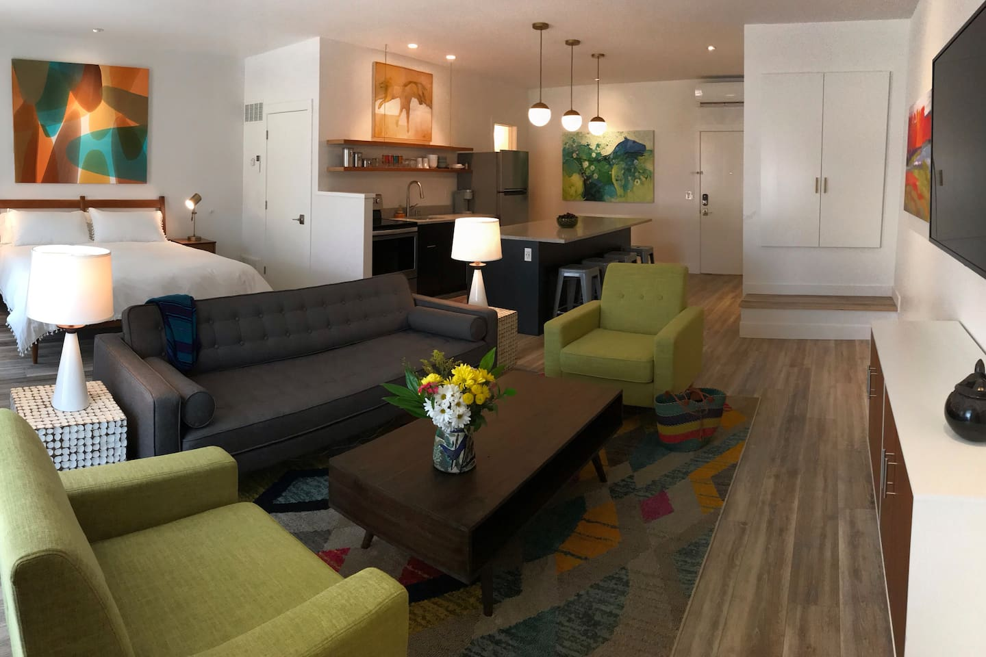 The Loft on Main is a new spacious studio apartment is filled with original art, comfortable furnishings, full kitchen and washer and dryer.