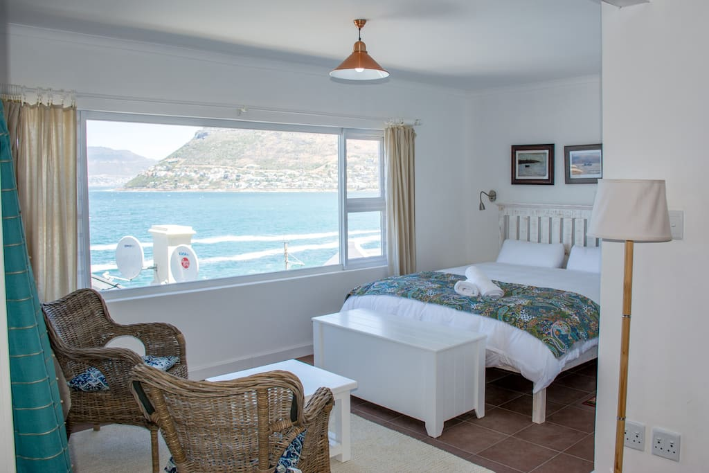Main Bedroom with stunning sea view, seating area, cupboard and shower space. Work desk for business travelers.