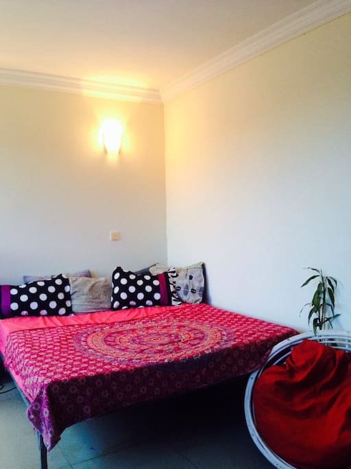Room with double bed, large windows and furnitures