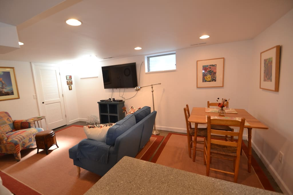 Small dining area with seating for 3.  Living room area is also seating for three