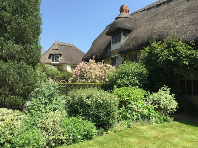 The Artist's Studio is approached through the picturesque gardens of The Manor House. As there are steps up to the Studio, it is unfortunately not suitable for those with limited mobility.