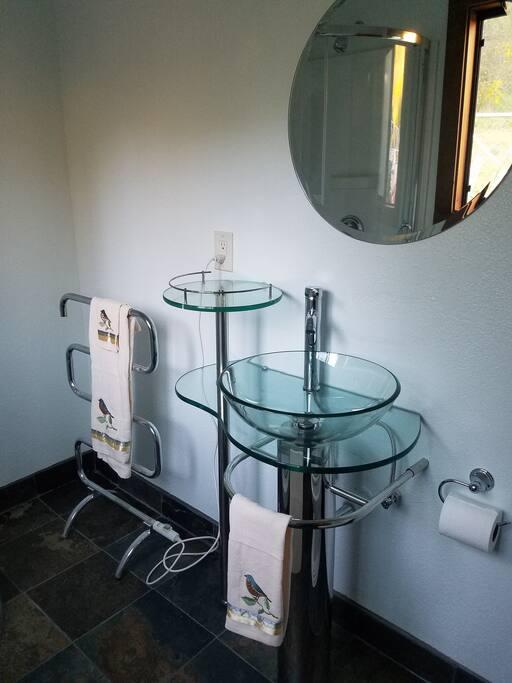Newly finished bathroom with heated towel rack.