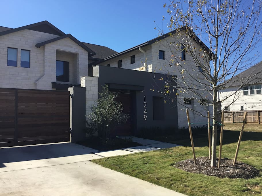 New modern home with controlled access entry and multi security camera coverage.