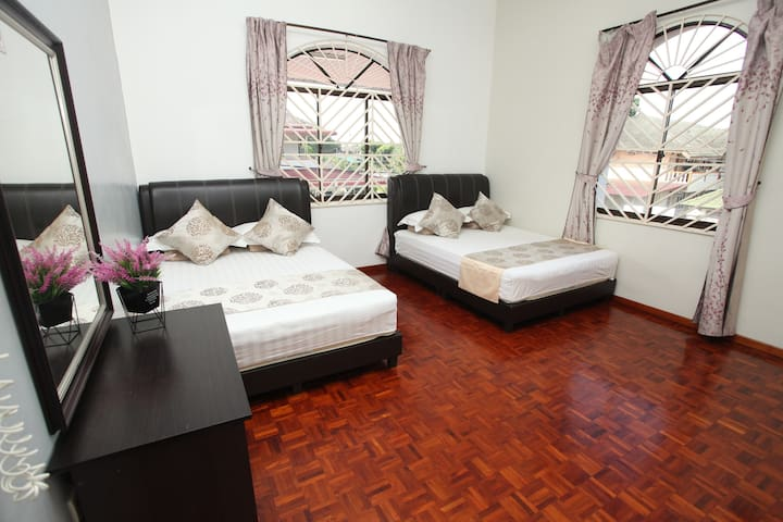 Room A, Two Double beds, private bathroom, First floor