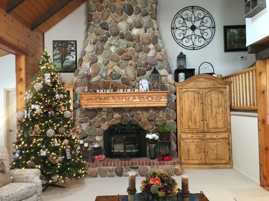 A grand wood-burning fireplace, the crowning glory of the cabin.
