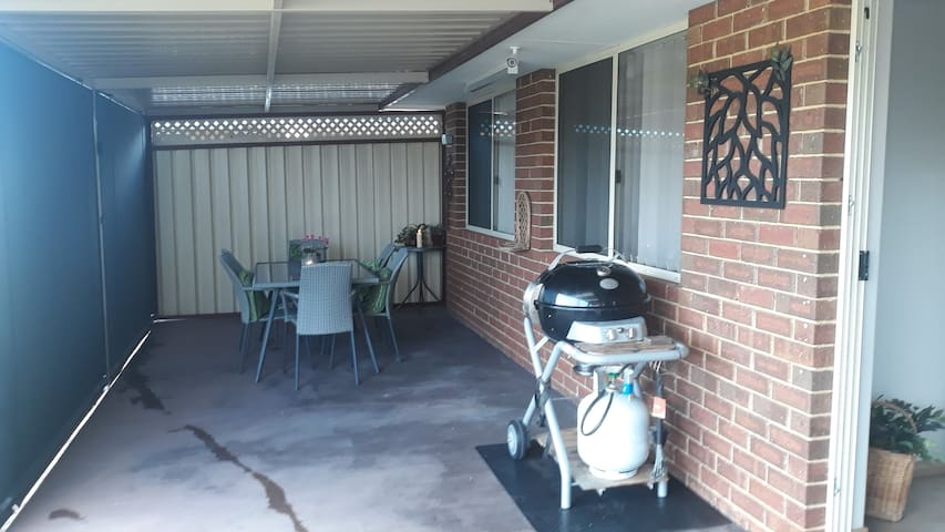 Lovely outdoor seating and bbq on the back patio