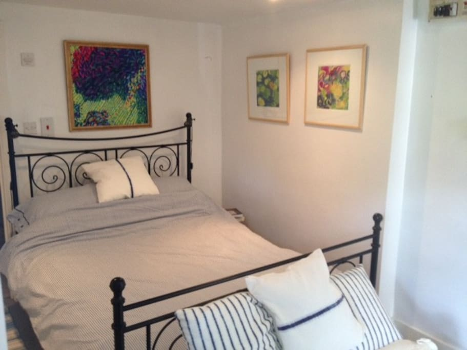 Comfortable room with artwork on the walls.