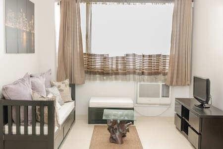 Cozy 1BR Condo in Ace Water Spa - Pasig City - Osakehuoneisto