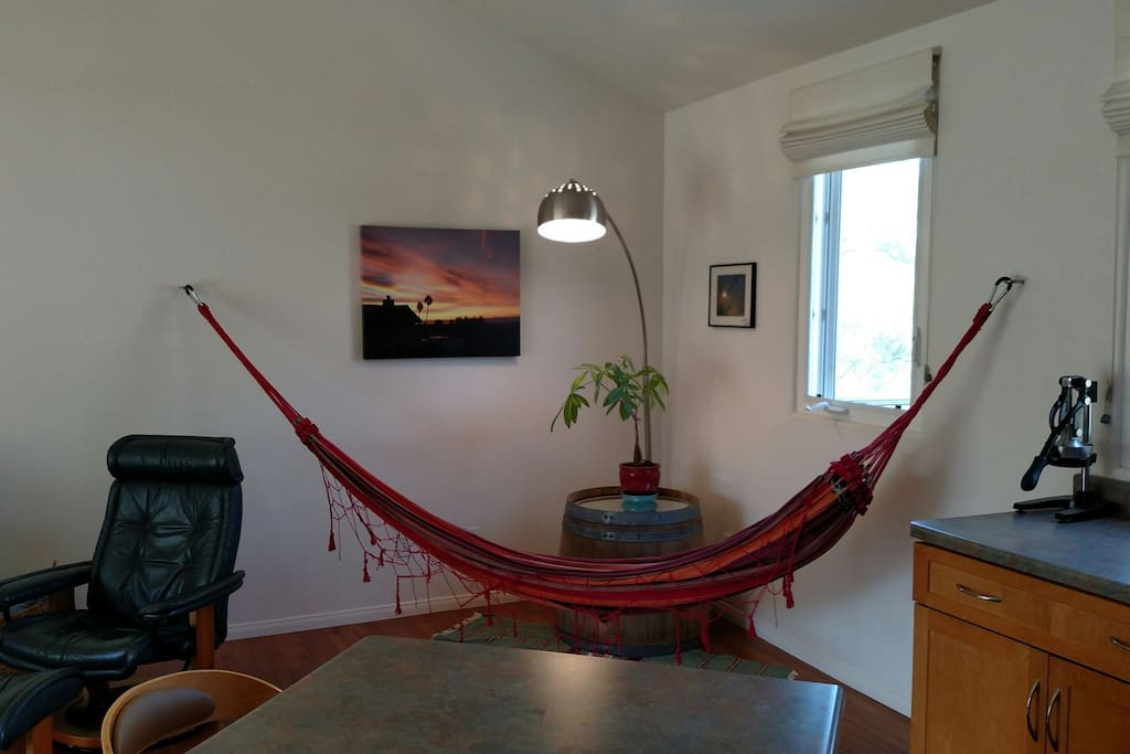 Relax in the upstairs hammock located in the shared living room.