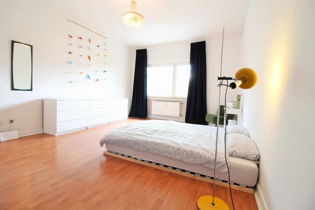 The bright and friendly bedroom with a clean and stylish furniture.