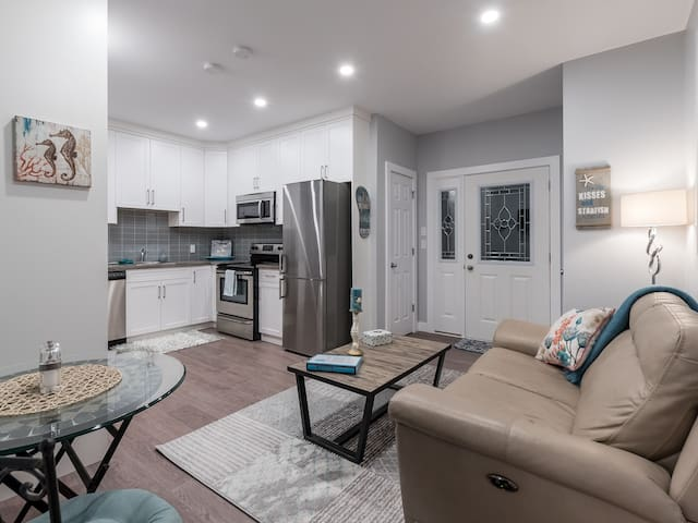 a cozy living space and full kitchen