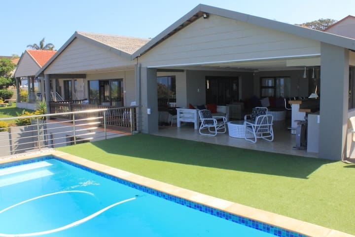 Heated pool adjacent to entertainment area