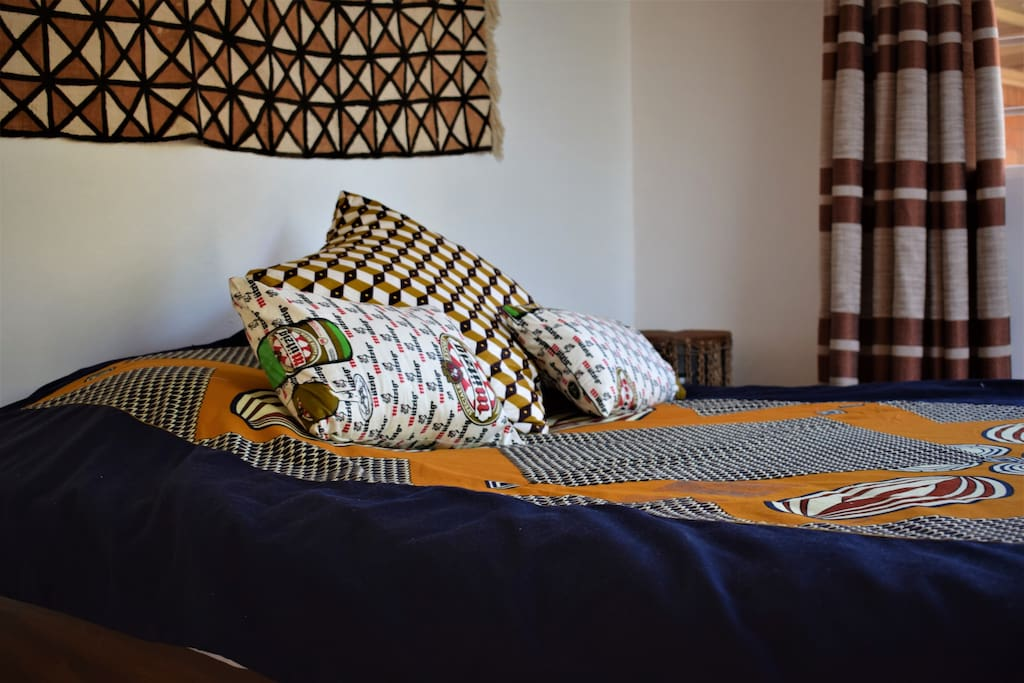 Local kitenge bedspread and pillows