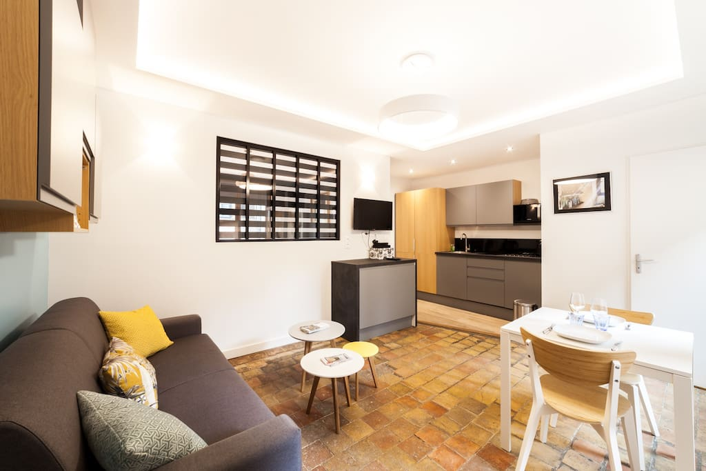 Salon séjour avec cuisine ouverte