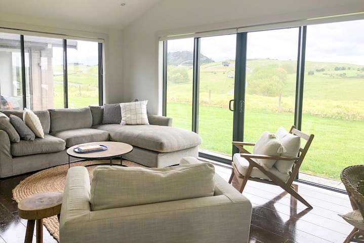 Cost second living room with stunning farm views