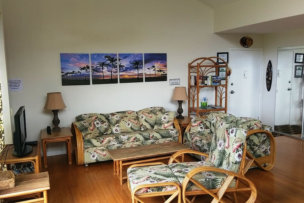 View of the living room. Nice decor with island style furniture and the couch is a queen size sofa bed. Very comfortable and chill. Relax fam