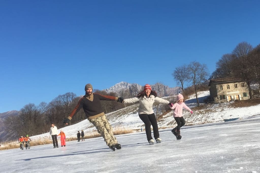 WINTER FUN: ice skating at lake of Crezzo, 5 minutes from the house