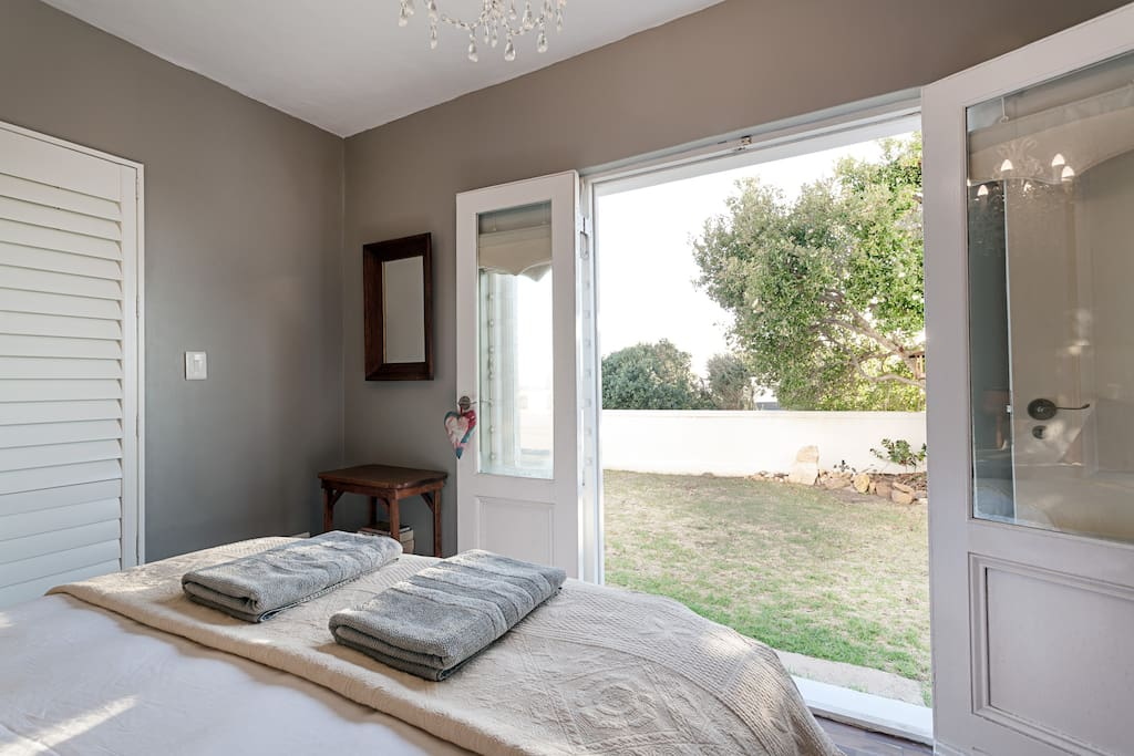 Bedroom opens out onto small private garden