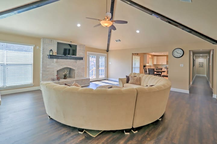 Take a seat on the large plush couch in the living room.