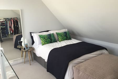 Loft bedroom in a modern home - Ludgershall