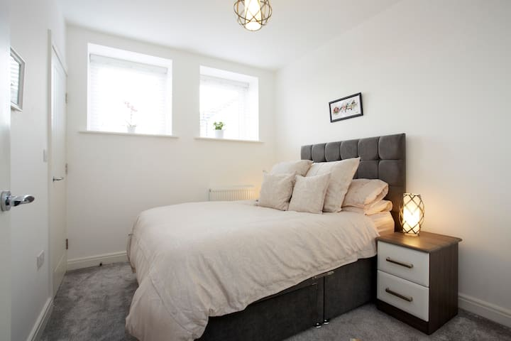 Bedroom with luxury bedding and built in wardrobe