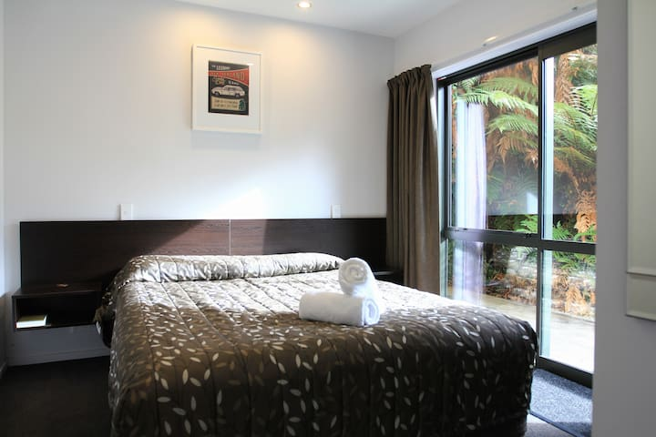 One of the bedrooms. Wake up in a comfortable queen-size bed with the stunning view of  the lush rainforest.