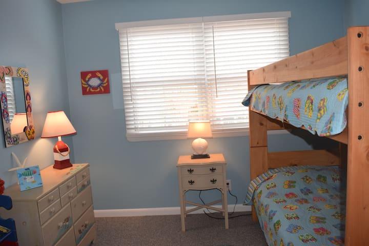 Flip flop room - kids bedroom with bunk beds, sandpiper dresser, kids books.